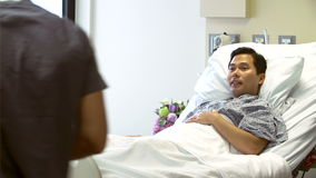 Nurse Talks To Male Patient In Hospital Room stock footage