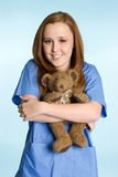 Nurse with Teddy Bear Stock Photos