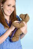 Nurse with Teddy Bear Royalty Free Stock Image
