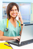 Nurse with telephone and laptop Stock Images