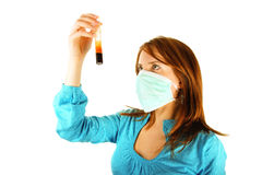 Nurse with test tube and mask Stock Images