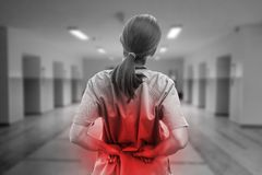 Nurse touching hurting back in black and white stock images