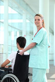 Nurse transporting man Stock Photo
