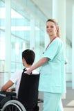 Nurse transporting man Stock Photo