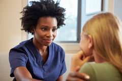 Nurse Treating Teenage Girl Suffering With Depression Stock Photography