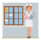 Nurse and the twins Royalty Free Stock Photography