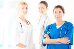 Nurse and two young doctors. In hospital Stock Photos