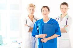Nurse and two young doctors. Near the hospital window Stock Images