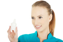 Nurse in uniform with hydrogen peroxide. Stock Images