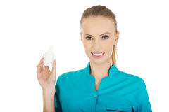 Nurse in uniform with hydrogen peroxide. Royalty Free Stock Photography