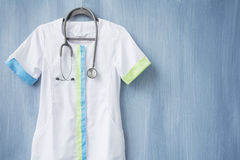 Nurse uniform with stethoscope on hanger Royalty Free Stock Photos