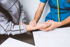 Nurse uses pulse handles at the wrists of elderly patients.  Stock Photography