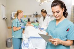Nurse Using Digital Tablet While Doctor And Royalty Free Stock Images