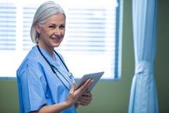 Nurse using digital tablet Stock Images