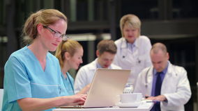 Nurse using laptop in conference room stock footage