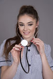 Nurse using a stethoscope Stock Images