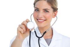 Nurse using stethoscope Stock Photography