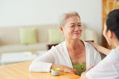 Nurse visiting patient at home stock images