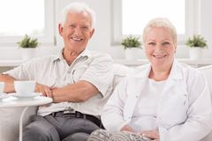 Nurse visiting senior man. Image of nice nurse visiting senior men at home Stock Image