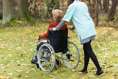 Nurse walking with disabled lady Royalty Free Stock Photography