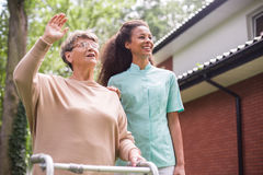 Nurse walking with patient Stock Photo