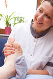Nurse washes the feet of a patient Royalty Free Stock Image
