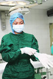 Nurse wearing gloves Stock Image