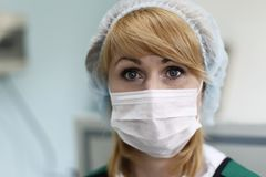 Nurse wearing a mask. City of Gomel Belarus 01 June 2017.Gomel medical hospital. Face of a nurse wearing a mask and hat stock photo
