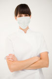 Nurse wearing protective mask with arms crossed Royalty Free Stock Images
