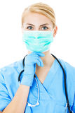 Nurse Wearing Surgical Mask Over White Background Stock Photography