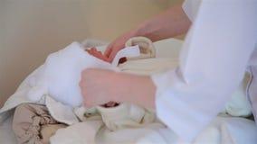 A nurse wears only a boy born. HD stock video footage