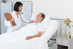Nurse whith her mature  patient Stock Image