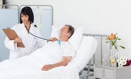 Nurse whith her mature  patient Stock Photography