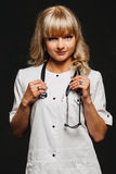 Nurse woman doctor in a white coat posing Stock Image