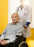 Nurse woman with senior man Royalty Free Stock Images