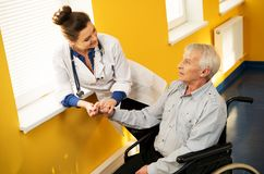 Nurse woman with senior man Stock Image