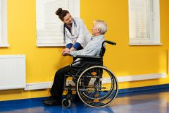 Nurse woman with senior man Royalty Free Stock Image
