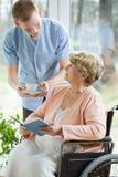 Nurse and woman on a wheelchair Stock Photo