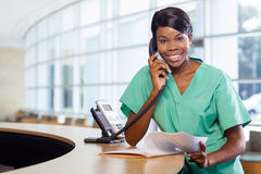 Nurse at work station Royalty Free Stock Image