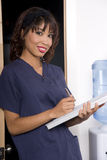 Pretty Young Nurse Working Medical Chart Clipboard Stock Images