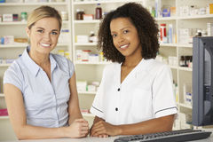 Nurse working on computer in pharmacy Stock Photos