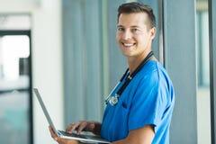 Nurse working laptop Stock Photos