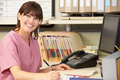 Nurse Working At Nurses Station Royalty Free Stock Photo