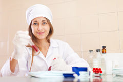 Nurse works with blood sample Stock Image