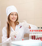 Nurse works with blood sample Royalty Free Stock Image