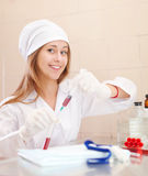 Nurse works with blood sample Stock Photos