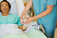 Nurse wrapping tensor Royalty Free Stock Photo