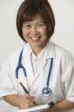 Nurse writing Stock Image