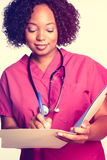 Nurse Writing in Chart Royalty Free Stock Photography