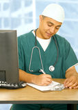 Nurse Writing On Clip Board Royalty Free Stock Photo